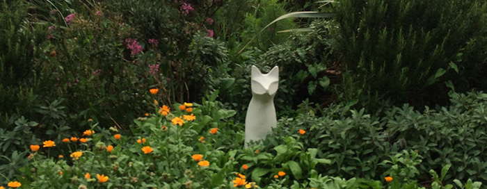 Ceramic fox sitting on the roundabout on London's Victoria Park Road