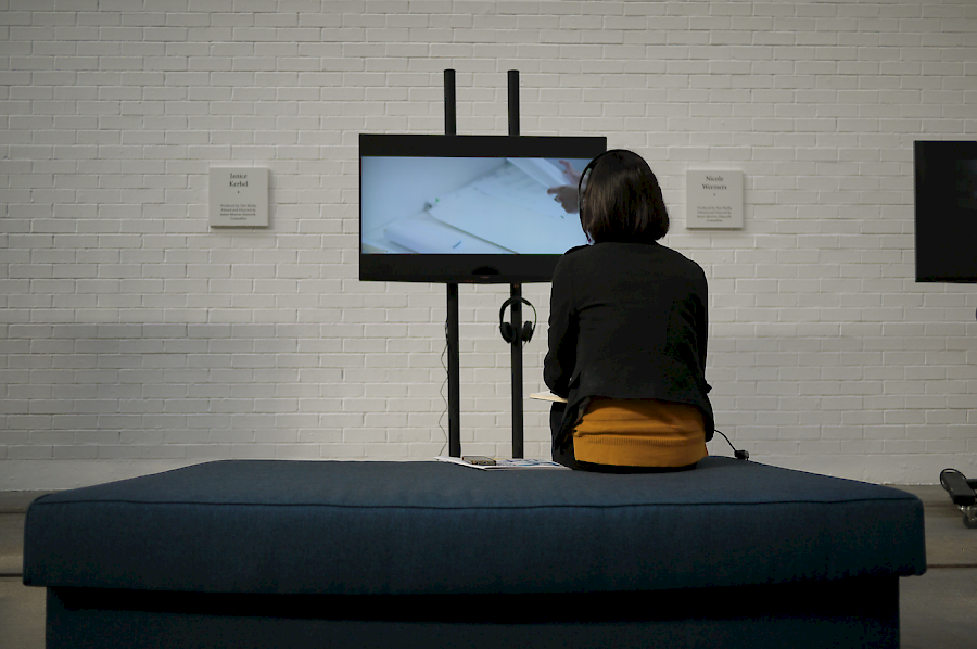 Tramway visitor watching film - part of 'Patterns' by Turner Prize artist, Bonnie Camplin