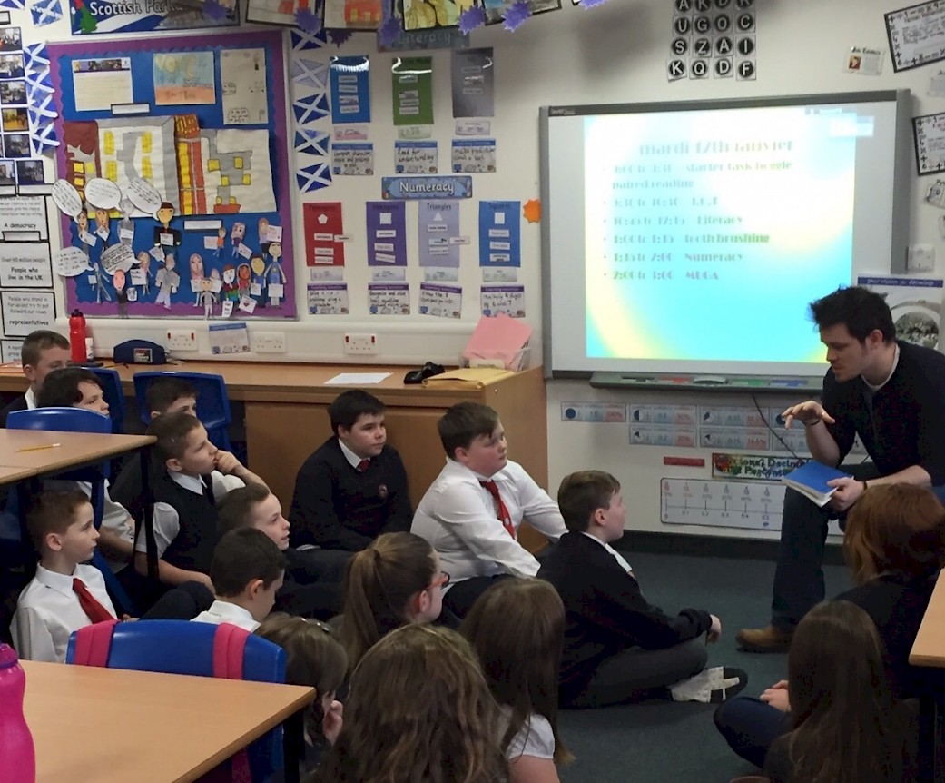 Frankie has the p7 pupils captivated by code!