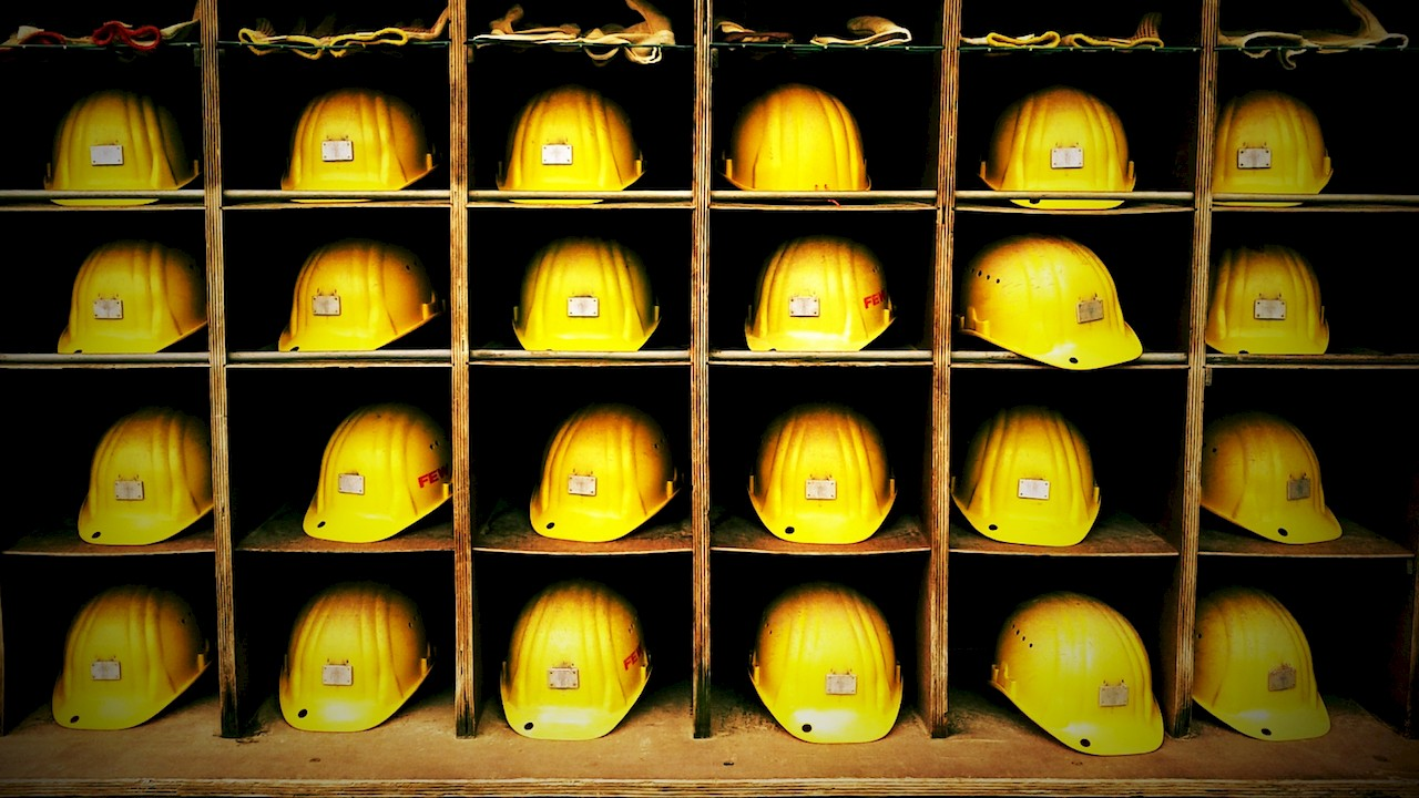Yellow hard hats in storage