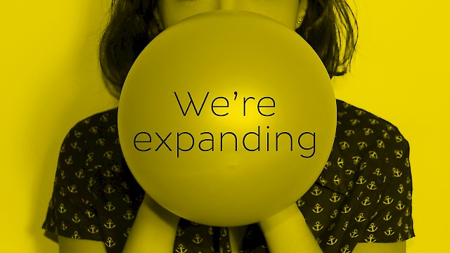 Girl blowing up a balloon - we're expanding - exciting Account Executive opportunity in our Glasgow studio